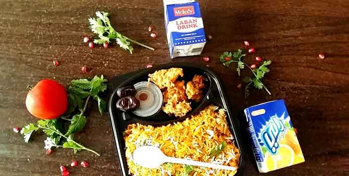 Packed meal with biryani, pakoras & more